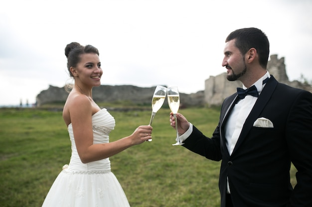Groom and bride toasting with champagne