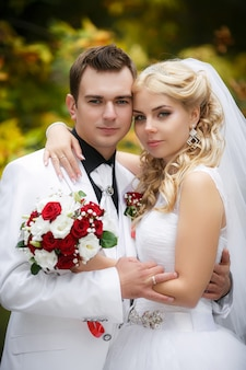 Groom and bride on walk in their wedding day
