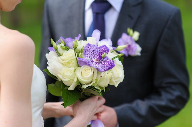 Groom and bride with a bouquet