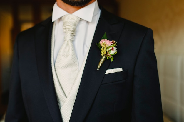 Groom dressing to go to his wedding