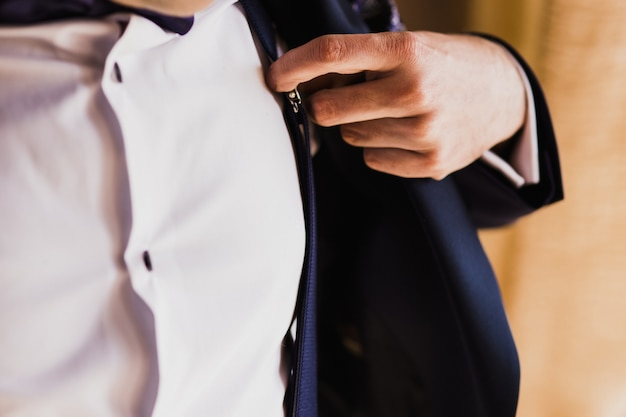 Groom getting ready to get married dressing