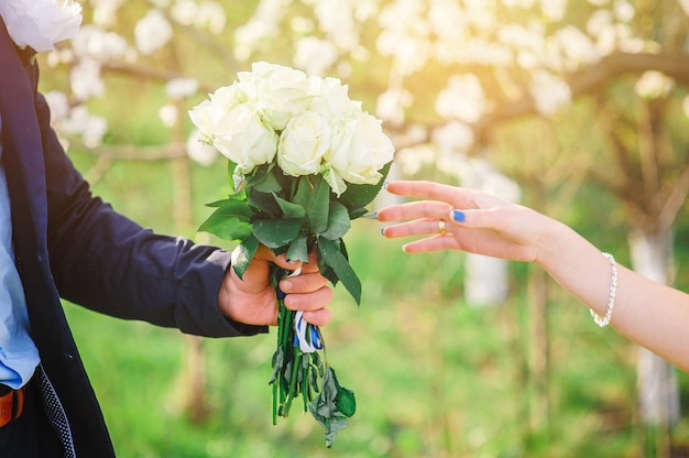 Groom gives his bride a beautiful wedding bouquet