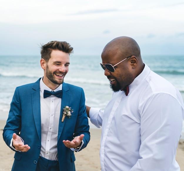 Groom and groomsman at the beach