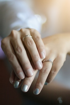 Groom hands holding bride hands with wedding ring in thai wedding ceremony traditional.