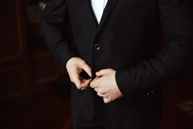 Groom is getting ready in the morning on a wedding day