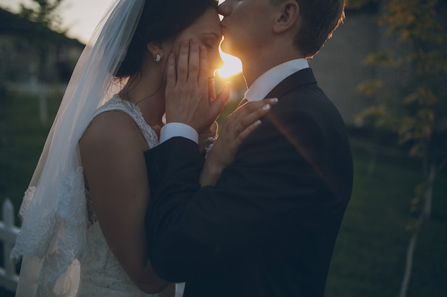 Groom kissing the bride's forehead