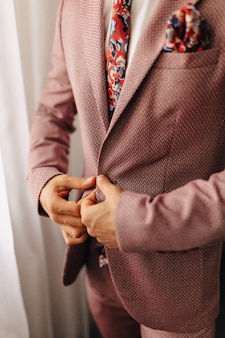 Groom meeting, details, jacket, shoes, watches and buttons on the wedding day