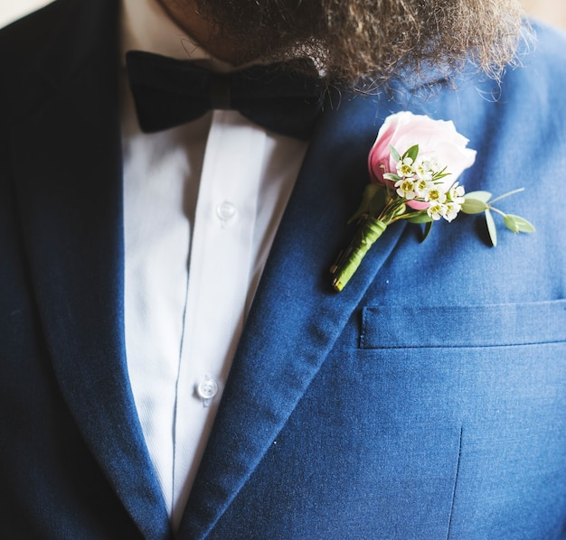 Groom in navy blue tuxedo wedding marriage ceremony