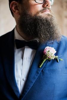 Groom in navy blue tuxedo wedding marriage ceremony