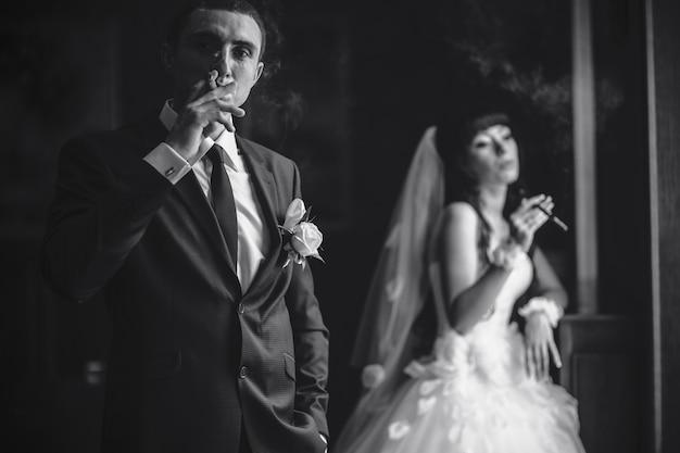 Groom puffing a cigar