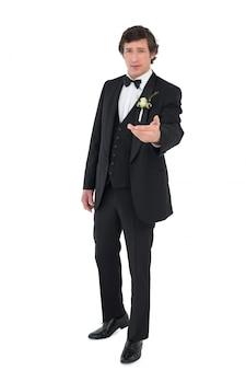 Groom in tuxedo offering hand