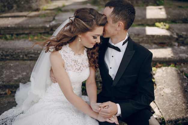 Groom whispering to his wife