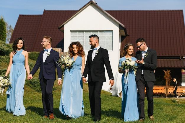Groomsmen and bridesmaids walking on wedding ceremony
