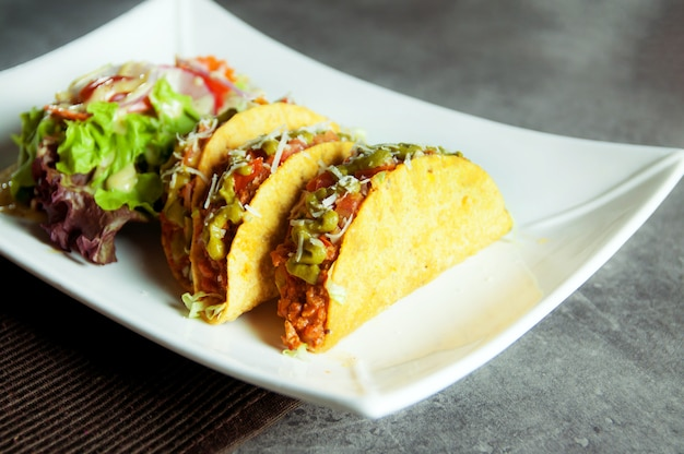 Ground beef tacos shells with salad