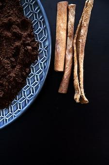 Ground coffee and cinnamon sticks