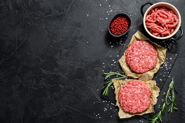 Ground raw meat patties. meat patties ready to cook. barbecue party.  farm organic meat. top view. copyspace background