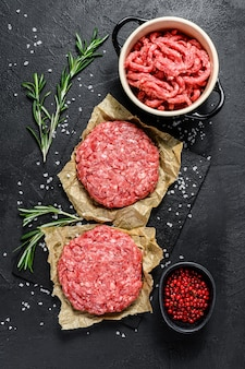 Ground raw meat patties. meat patties ready to cook. barbecue party.  farm organic meat. top view