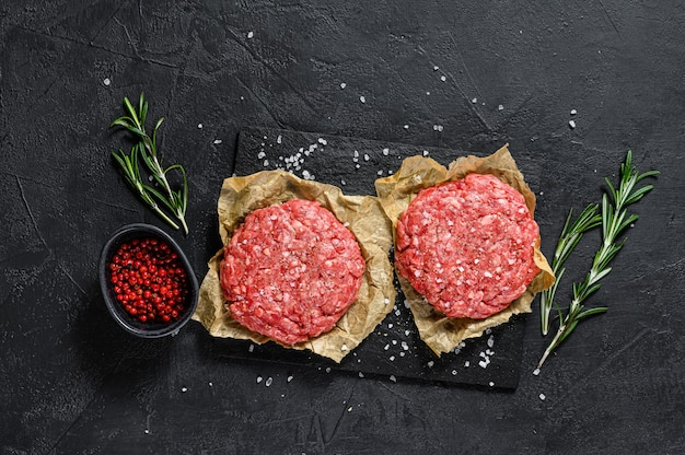 Ground raw meat patties. meat patties ready to cook. barbecue party.  farm organic meat. top view.