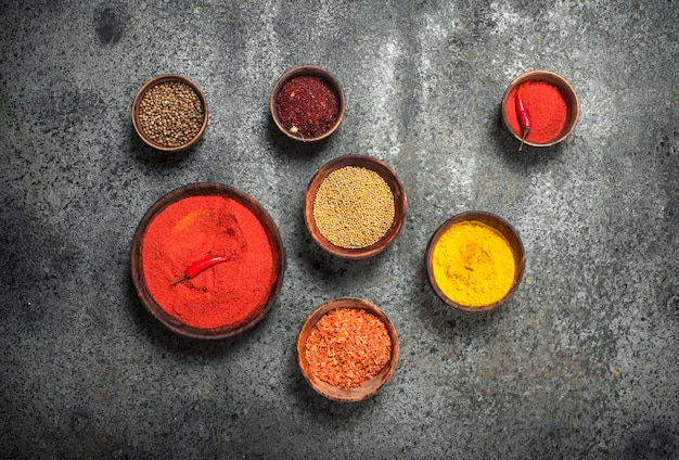 Ground spices in bowls. on a rustic background.