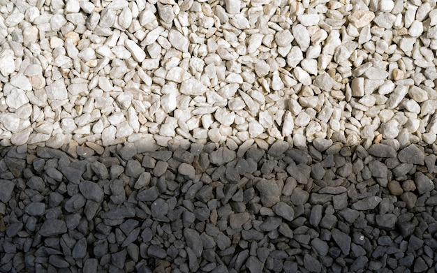 Ground stone grey background of many small stones on the light shine. white pebble on the small garden ground inside the house.