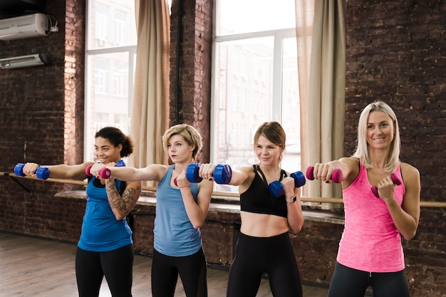 Group of adult women working out together