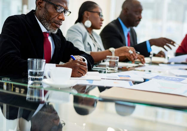 A group of african descent business people in a meeting