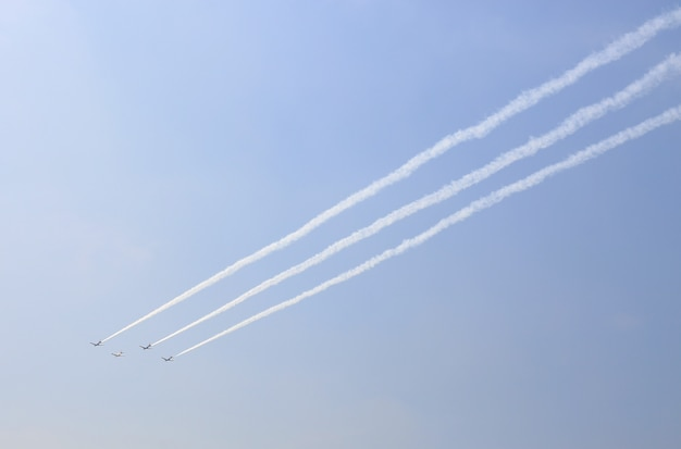 Group of aircraft were smoking under sky