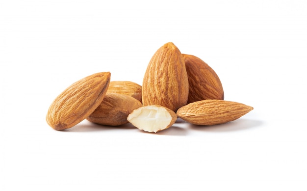 Group of almonds nuts isolated on white