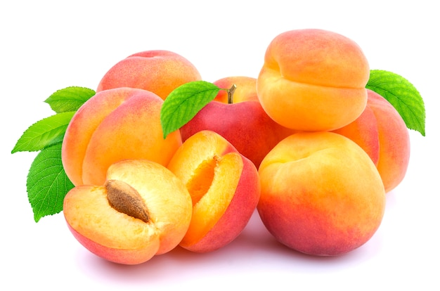 Group of apricots with leaves isolated