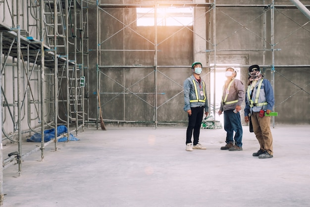 Group of architecture inspection work mosonry work in construction site