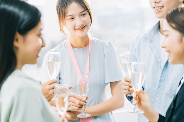 Group asian business people are having a toast together and chatting at a company party