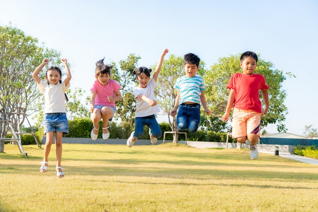Group of asian kindergarten kids playing and jumping together