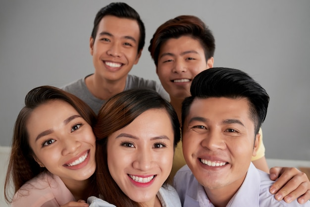 Group of asian male and female friends posing together