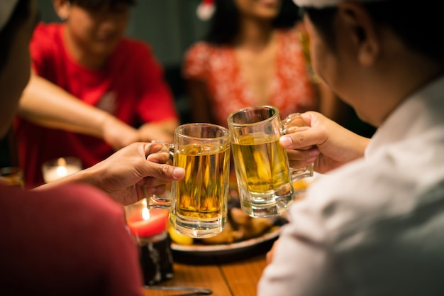 Group of asian people have a dinner party and beer at home