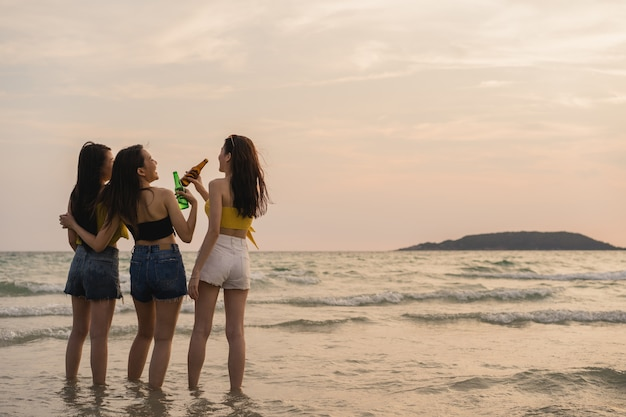 Group of asian teenage girls having party celebrating on beach