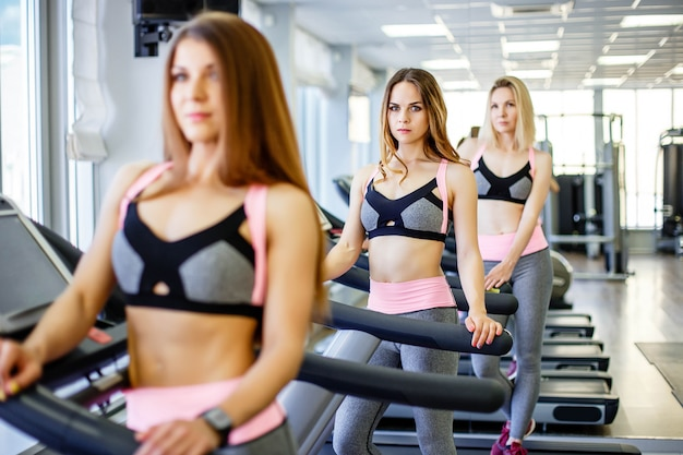 A group of athletic girls posing for the camera in the gym