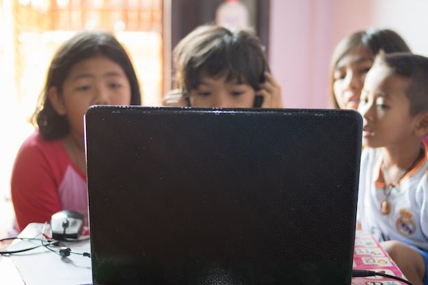 Group of baby using notebook