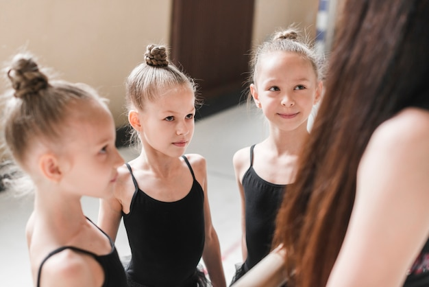 Group of ballerina girls with their teacher
