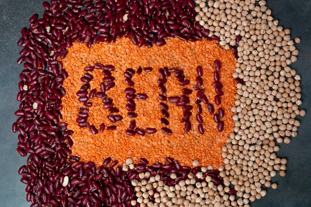 Group of beans, lentils and chick-pea  on black background. beans assortment. sign