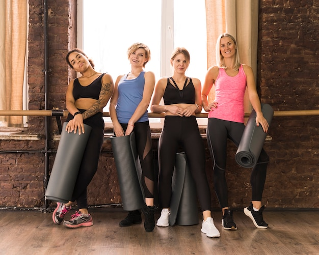 Group of beautiful adult women together at the gym