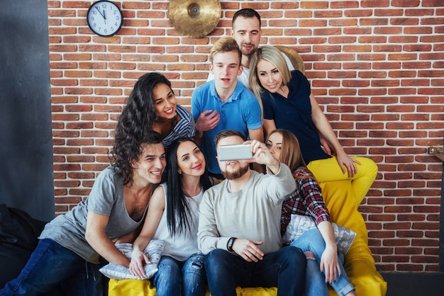 Group beautiful young people doing selfie in a cafe, best friends girls and boys together having fun, posing emotional lifestyle