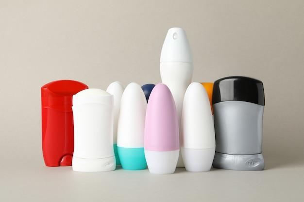Group of body deodorants on gray