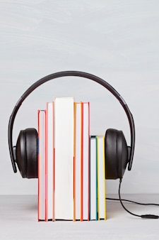 Group of books with the earphones. audiobooks concept