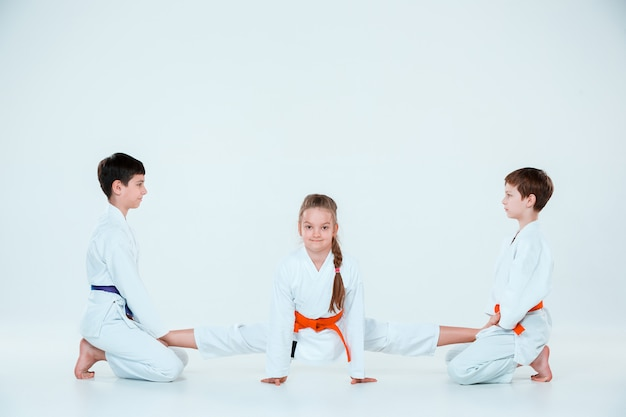 Group of boys and girl at aikido training in martial arts school. healthy lifestyle and sports concept