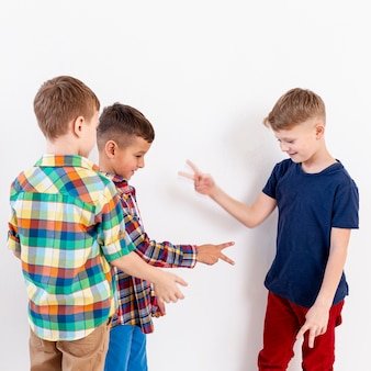 Group of boys playing rock scissors paper game