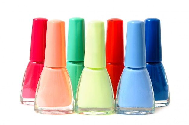 Group of bright nail polishes isolated on white.