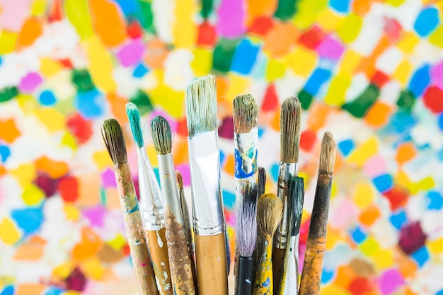 Group of brushes on colorful background