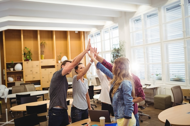 Group of business executives giving high five