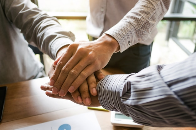 Group of business partner team hands put together at workplace