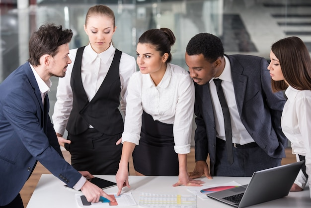 Group of business people are discuss a project.